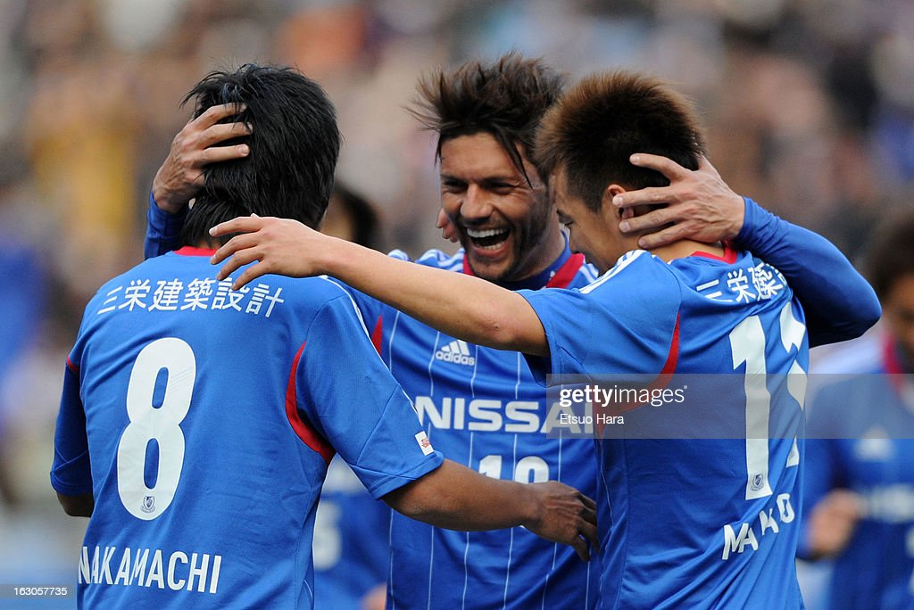 Marquinhos (C) of Yokohama F.Marinos celebrates scoirng the fourth goal with his teammates Kosuke Nakamachi (L) and <a gi-track='captionPersonalityLinkClicked' href=/galleries/search?phrase=Manabu+Saito&family=editorial&specificpeople=8042784 ng-click='$event.stopPropagation()'>Manabu Saito</a> during the J.League match between Yokohama F.Marinos and Shonan Bellmare at Nissan Stadium on March 2, 2013 in Yokohama, Kanagawa, Japan.