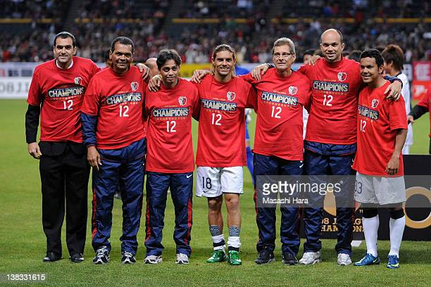 Marquinhos whose real name is Marcos Gomes de Araujo and head coach Oswaldo Oliveira of Kashima Antlers staffs pose for photographs after becoming...