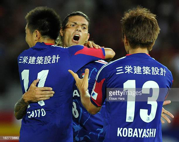 Marquinhos whose real name is Marcos Gomes de Araujo of Yokohama FMarinos celebrates scoring the first goal with his team mates Manabu Saito and Yuzo...