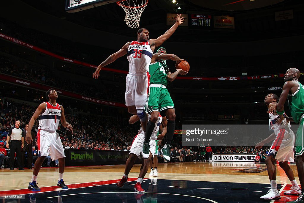 <a gi-track='captionPersonalityLinkClicked' href=/galleries/search?phrase=Marquis+Daniels&family=editorial&specificpeople=202465 ng-click='$event.stopPropagation()'>Marquis Daniels</a> #4 of the Boston Celtics goes to the basket against Trevor Booker #35 of the Washington Wizards during the game between the Washington Wizards and the Boston Celtics at the Verizon Center on January 22, 2012 in Washington, DC.