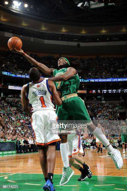 Marquis Daniels of the Boston Celtics shoots a layup against Chris Duhon of the New York Knicks during the game at The TD Garden on March 17 2010 in...