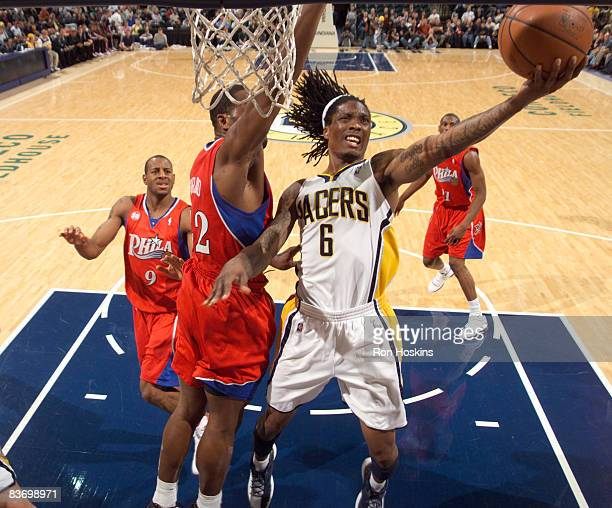 Marquis Daniels of the Indiana Pacers shoots over Elton Brand of the Philadelphia 76ers at Conseco Fieldhouse on November 14 2008 in Indianapolis...