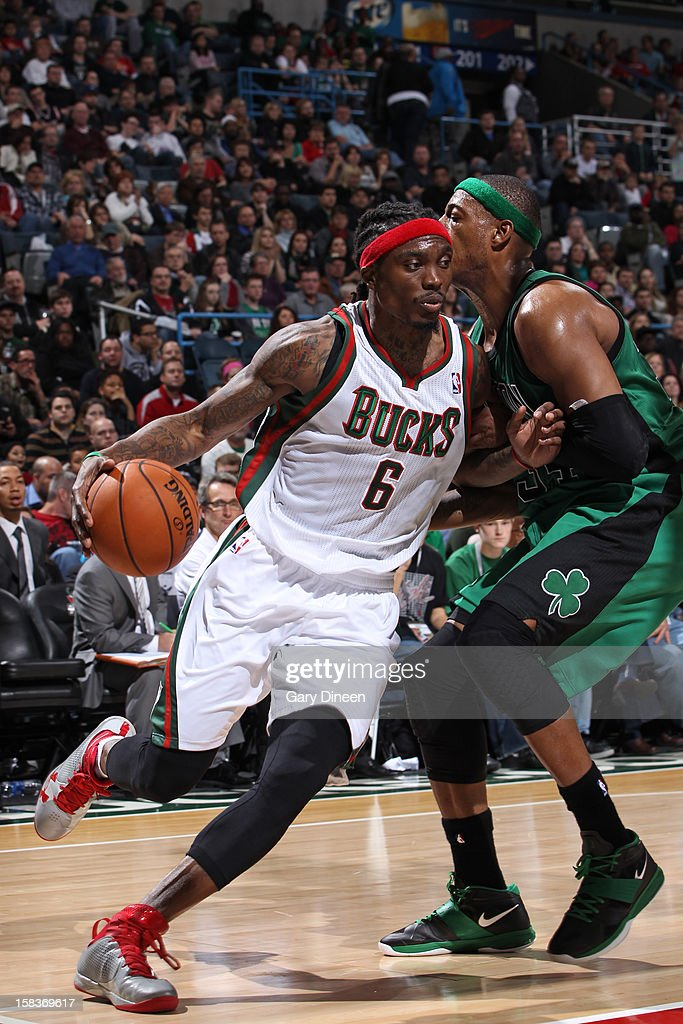 <a gi-track='captionPersonalityLinkClicked' href=/galleries/search?phrase=Marquis+Daniels&family=editorial&specificpeople=202465 ng-click='$event.stopPropagation()'>Marquis Daniels</a> #6 of the Milwaukee Bucks drives to the basket against <a gi-track='captionPersonalityLinkClicked' href=/galleries/search?phrase=Paul+Pierce&family=editorial&specificpeople=201562 ng-click='$event.stopPropagation()'>Paul Pierce</a> #34 of the Boston Celtics on December 1, 2012 at the BMO Harris Bradley Center in Milwaukee, Wisconsin.