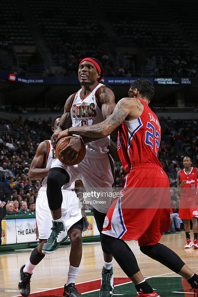 <a gi-track='captionPersonalityLinkClicked' href=/galleries/search?phrase=Marquis+Daniels&family=editorial&specificpeople=202465 ng-click='$event.stopPropagation()'>Marquis Daniels</a> #6 of the Milwaukee Bucks drives to the basket against <a gi-track='captionPersonalityLinkClicked' href=/galleries/search?phrase=Matt+Barnes+-+Basketball+Player&family=editorial&specificpeople=202880 ng-click='$event.stopPropagation()'>Matt Barnes</a> #22 of the Los Angeles Clippers on December 15, 2012 at the BMO Harris Bradley Center in Milwaukee, Wisconsin.