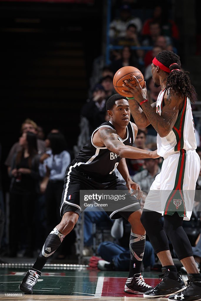 <a gi-track='captionPersonalityLinkClicked' href=/galleries/search?phrase=Marquis+Daniels&family=editorial&specificpeople=202465 ng-click='$event.stopPropagation()'>Marquis Daniels</a> #6 of the Milwaukee Bucks looks to pass the ball against the Brooklyn Nets on December 26, 2012 at the BMO Harris Bradley Center in Milwaukee, Wisconsin.