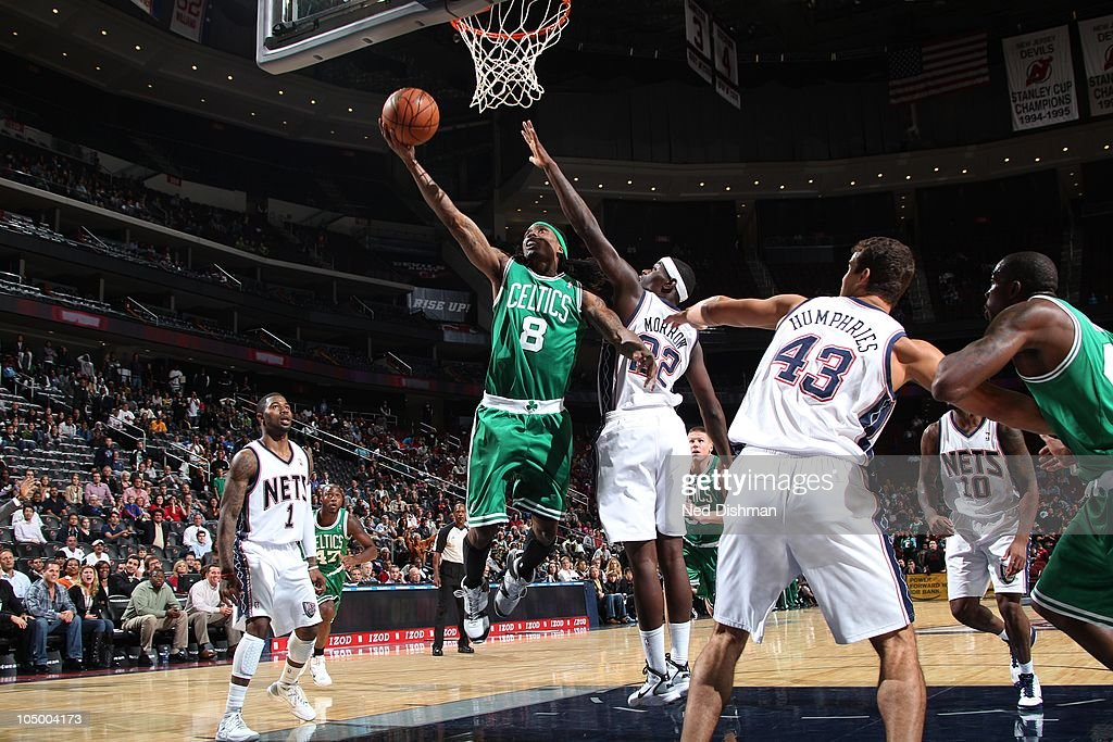 <a gi-track='captionPersonalityLinkClicked' href=/galleries/search?phrase=Marquis+Daniels&family=editorial&specificpeople=202465 ng-click='$event.stopPropagation()'>Marquis Daniels</a> #8 of the New Jersey Nets shoots against <a gi-track='captionPersonalityLinkClicked' href=/galleries/search?phrase=Anthony+Morrow&family=editorial&specificpeople=814354 ng-click='$event.stopPropagation()'>Anthony Morrow</a> #22 of the Boston Celtics on October 7, 2010 at the Prudential Center in Newark, New Jersey.