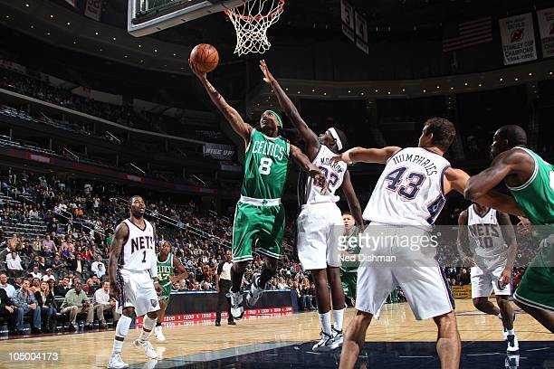 Marquis Daniels of the New Jersey Nets shoots against Anthony Morrow of the Boston Celtics on October 7 2010 at the Prudential Center in Newark New...