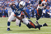 Marquis Flowers of the Cincinnati Bengals tackles Trent Richardson of the Indianapolis Colts during the fourth quarter on October 19 2014 at Lucas...