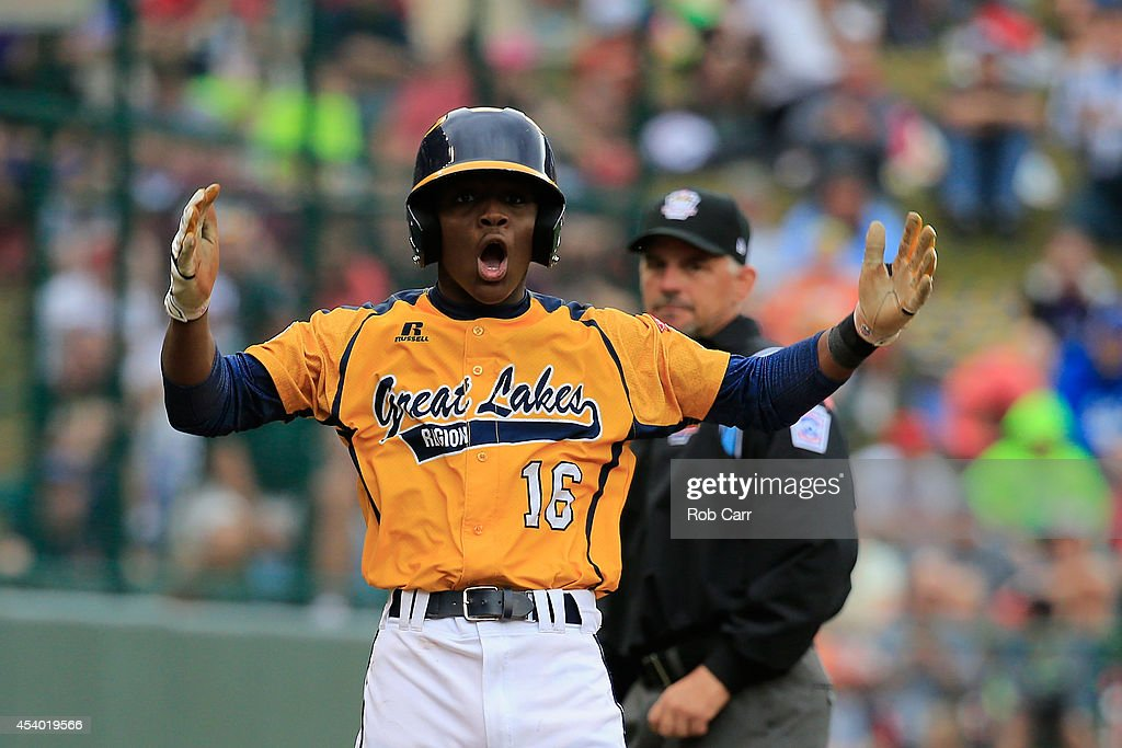 Marquis Jackson #16 of the Great Lakes Team from Chicago, Illinois celebrates after stealing third base against the West Team from Las Vegas, Nevada during the first inning of the United States Championship game of the Little League World Series at Lamade Stadium on August 23, 2014 in South Williamsport, Pennsylvania.