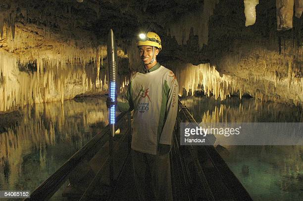 Marquis Jones navigates the suspended bridge at the Crystal and Fantasy Caves of Bermuda on August 31 2005 in Bermuda The caves are naturally...