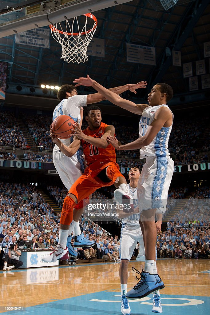 Marquis Rankin #10 of the Virginia Tech Hokies passes the ball around James Michael McAdoo #43 and Brice Johnson #11 of the North Carolina Tar Heels on February 02, 2013 at the Dean E. Smith Center in Chapel Hill, North Carolina. North Carolina won 60-72 in overtime.