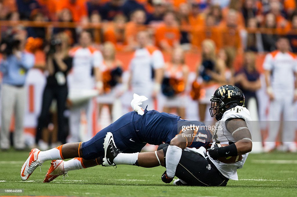 Marquis Spruill #11 of Syracuse Orange stops Dominique Gibson #14 of Wake Forest Demon Deacons forcing a fourth down in the first quarter on November 2, 2013 at the Carrier Dome in Syracuse, New York. Syracuse shuts out Wake Forest 13-0