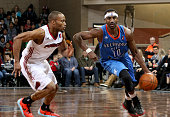 Marquis Teague from the Oklahoma City Blue drives past Tre Kelley from the Sioux Falls Skyforce at the Sanford Pentagon December 25 2015 in Sioux...