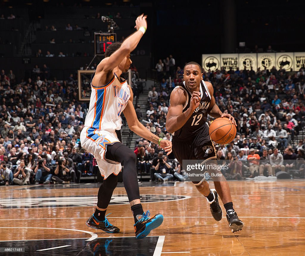 <a gi-track='captionPersonalityLinkClicked' href=/galleries/search?phrase=Marquis+Teague&family=editorial&specificpeople=7621183 ng-click='$event.stopPropagation()'>Marquis Teague</a> #12 of the Brooklyn Nets dribbles against <a gi-track='captionPersonalityLinkClicked' href=/galleries/search?phrase=Jeremy+Lamb&family=editorial&specificpeople=7407506 ng-click='$event.stopPropagation()'>Jeremy Lamb</a> #11 of the Oklahoma City Thunder at the Barclays Center on January 31, 2014 in the Brooklyn borough of New York City.