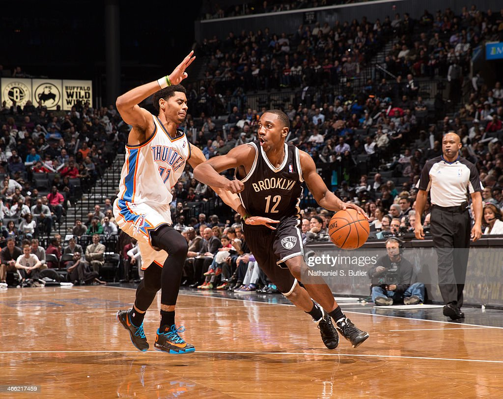 <a gi-track='captionPersonalityLinkClicked' href=/galleries/search?phrase=Marquis+Teague&family=editorial&specificpeople=7621183 ng-click='$event.stopPropagation()'>Marquis Teague</a> #12 of the Brooklyn Nets dribbles against <a gi-track='captionPersonalityLinkClicked' href=/galleries/search?phrase=Jeremy+Lamb&family=editorial&specificpeople=7407506 ng-click='$event.stopPropagation()'>Jeremy Lamb</a> #11 of the Oklahoma City Thunder the Barclays Center on January 31, 2014 in the Brooklyn borough of New York City.