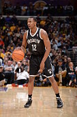 Marquis Teague of the Brooklyn Nets dribbles the ball against the Los Angeles Lakers at STAPLES Center on February 23 2014 in Los Angeles California...