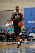 Marquis Teague of the Brooklyn Nets dribbles the ball against the Houston Rockets during the game during the Samsung NBA Summer League 2014 on July...
