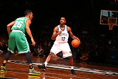 Marquis Teague of the Brooklyn Nets handles the ball against the Boston Celtics on October 19 2014 at Barclays Center in Brooklyn New York NOTE TO...