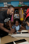 Marquis Teague of the Brooklyn Nets participates at NBA Cares Employee Day of Service school revitalization and cafeteria makeover on September 22...