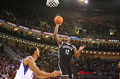 Marquis Teague of the Brooklyn Nets shoots against Ryan Hollins of the Sacramento Kings as part of the 2014 NBA Global Games at the MasterCard Center...