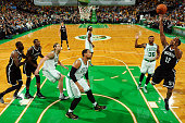 Marquis Teague of the Brooklyn Nets shoots against the Boston Celtics during the game on October 22 2014 at the TD Garden in Boston Massachusetts...