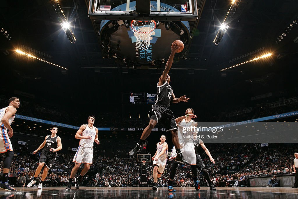 <a gi-track='captionPersonalityLinkClicked' href=/galleries/search?phrase=Marquis+Teague&family=editorial&specificpeople=7621183 ng-click='$event.stopPropagation()'>Marquis Teague</a> #12 of the Brooklyn Nets shoots against the Oklahoma City Thunder at the Barclays Center on January 31, 2014 in the Brooklyn borough of New York City.