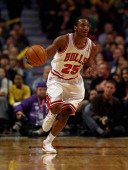 Marquis Teague of the Chicago Bulls brings the ball up the court against the Boston Celtics at the United Center on November 12 2012 in Chicago...