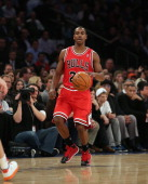 Marquis Teague of the Chicago Bulls dribbles the ball against the New York Knicks at Madison Square Garden on December 11 2013 in New York City The...