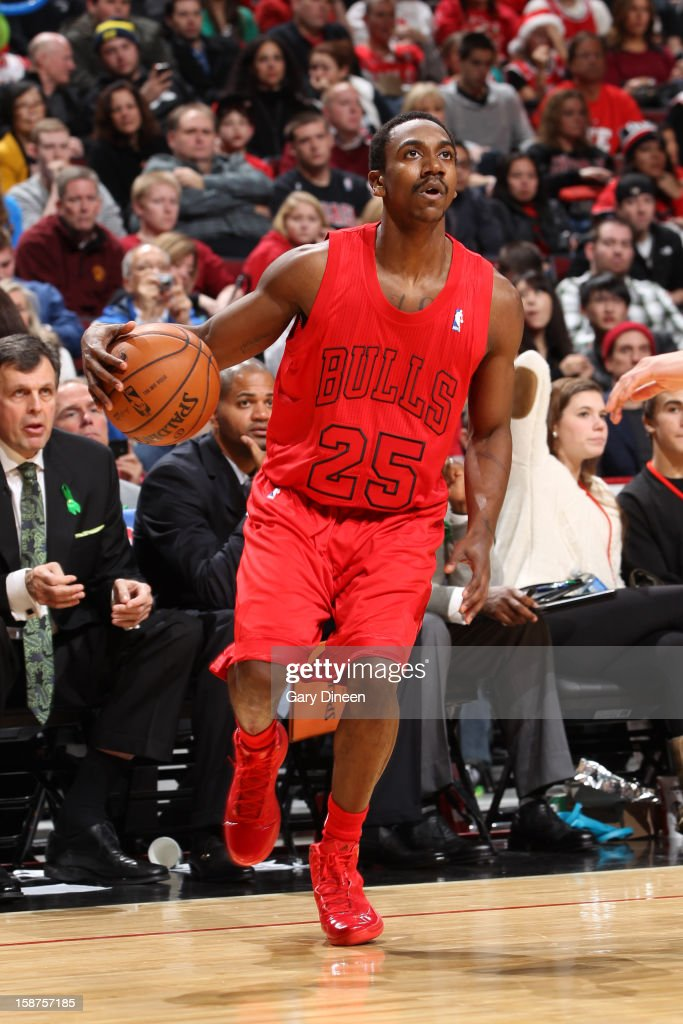 <a gi-track='captionPersonalityLinkClicked' href=/galleries/search?phrase=Marquis+Teague&family=editorial&specificpeople=7621183 ng-click='$event.stopPropagation()'>Marquis Teague</a> #25 of the Chicago Bulls dribbles the ball against the Houston Rockets during a Christmas Day game on December 25, 2012 at the United Center in Chicago, Illinois.