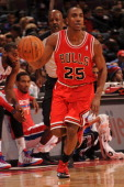 Marquis Teague of the Chicago Bulls dribbles the ball against the Detroit Pistons on November 27 2013 at The Palace of Auburn Hills in Auburn Hills...