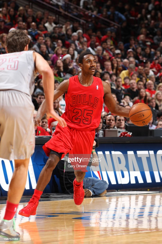 <a gi-track='captionPersonalityLinkClicked' href=/galleries/search?phrase=Marquis+Teague&family=editorial&specificpeople=7621183 ng-click='$event.stopPropagation()'>Marquis Teague</a> #25 of the Chicago Bulls dribbles the ball up court against the Houston Rockets during a Christmas Day game on December 25, 2012 at the United Center in Chicago, Illinois.