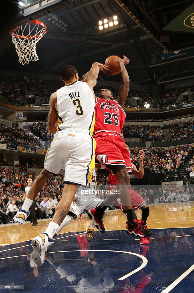 Marquis Teague #25 of the Chicago Bulls goes to the basket against George Hill #3 of the Indiana Pacers during the game between the Indiana Pacers and the Chicago Bulls on February 4, 2013 at Bankers Life Fieldhouse in Indianapolis, Indiana.