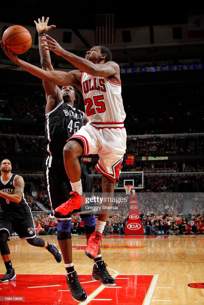 <a gi-track='captionPersonalityLinkClicked' href=/galleries/search?phrase=Marquis+Teague&family=editorial&specificpeople=7621183 ng-click='$event.stopPropagation()'>Marquis Teague</a> #25 of the Chicago Bulls goes to the basket against <a gi-track='captionPersonalityLinkClicked' href=/galleries/search?phrase=Gerald+Wallace&family=editorial&specificpeople=202117 ng-click='$event.stopPropagation()'>Gerald Wallace</a> #45 of the Brooklyn Nets on December 15, 2012 at the United Center in Chicago, Illinois.