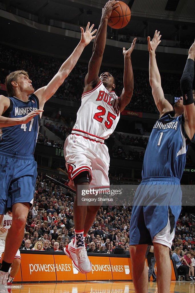 <a gi-track='captionPersonalityLinkClicked' href=/galleries/search?phrase=Marquis+Teague&family=editorial&specificpeople=7621183 ng-click='$event.stopPropagation()'>Marquis Teague</a> #25 of the Chicago Bulls goes to the basket between <a gi-track='captionPersonalityLinkClicked' href=/galleries/search?phrase=Andrei+Kirilenko&family=editorial&specificpeople=201909 ng-click='$event.stopPropagation()'>Andrei Kirilenko</a> #47 and <a gi-track='captionPersonalityLinkClicked' href=/galleries/search?phrase=Alexey+Shved&family=editorial&specificpeople=5557761 ng-click='$event.stopPropagation()'>Alexey Shved</a> #1 of the Minnesota Timberwolves on November 10, 2012 at the United Center in Chicago, Illinois.