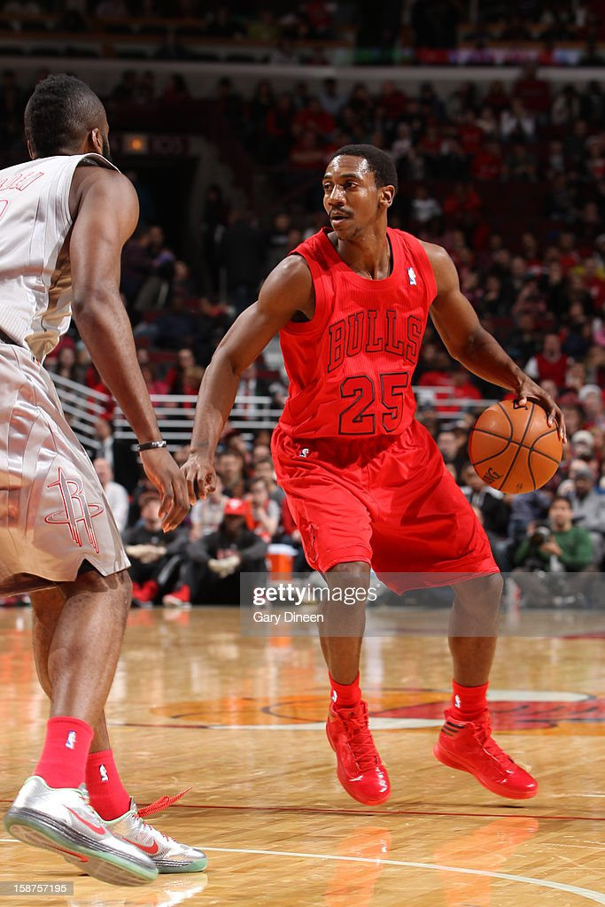 Marquis Teague #25 of the Chicago Bulls looks to drive to the basket against the Houston Rockets during a Christmas Day game on December 25, 2012 at the United Center in Chicago, Illinois.