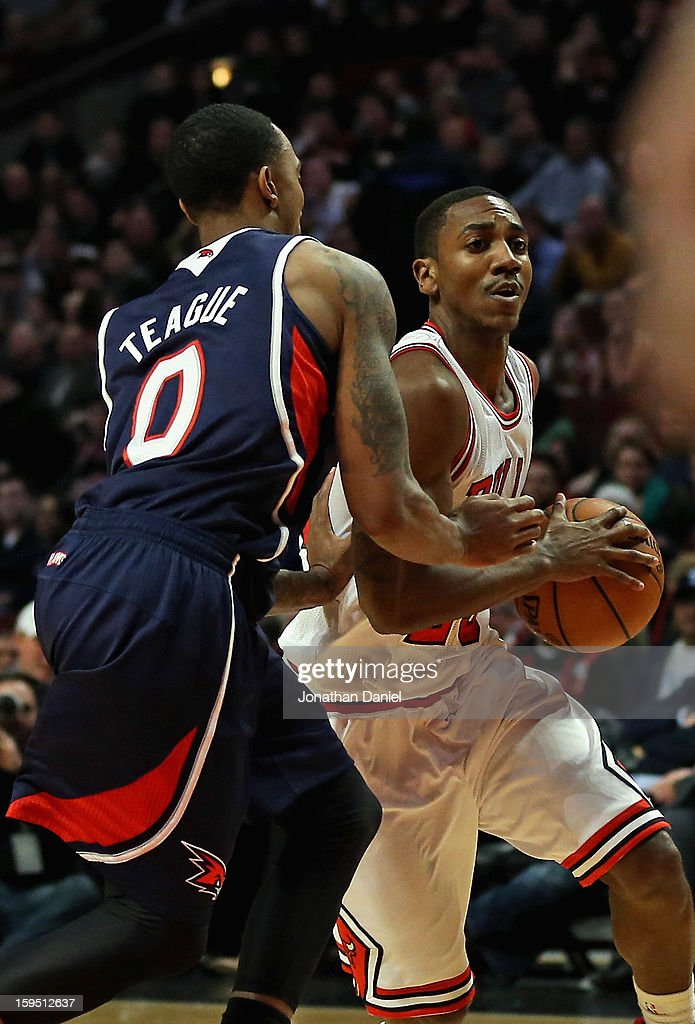 <a gi-track='captionPersonalityLinkClicked' href=/galleries/search?phrase=Marquis+Teague&family=editorial&specificpeople=7621183 ng-click='$event.stopPropagation()'>Marquis Teague</a> #25 of the Chicago Bulls plays against his older borther, <a gi-track='captionPersonalityLinkClicked' href=/galleries/search?phrase=Jeff+Teague&family=editorial&specificpeople=4680498 ng-click='$event.stopPropagation()'>Jeff Teague</a> #0 of the Atlanta Hawks at the United Center on January 14, 2013 in Chicago, Illinois. The Bulls defeated the Hawks 97-58.