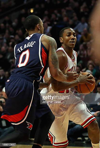 Marquis Teague of the Chicago Bulls plays against his older borther Jeff Teague of the Atlanta Hawks at the United Center on January 14 2013 in...