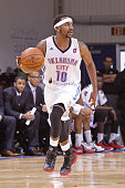 Marquis Teague of the Oklahoma City Blue dribbles the ball against the Grand Rapids Drive during the 2016 NBA DLeague Showcase on January 8 2016 at...
