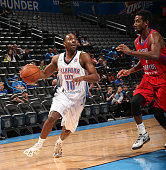 Marquis Teague of the Oklahoma City Blue drives against Malcolm Lee of the Grand Rapids Drive during an NBA DLeague game on March 15 2015 at the...