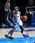 Marquis Teague of the Oklahoma City Blue drives the ball against Bryce Cotton of the Austin Spurs during an NBA DLeague game on January 24 2015 at...