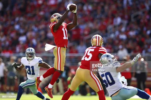 Marquise Goodwin of the San Francisco 49ers makes a catch against the Dallas Cowboys during their NFL game at Levi's Stadium on October 22 2017 in...