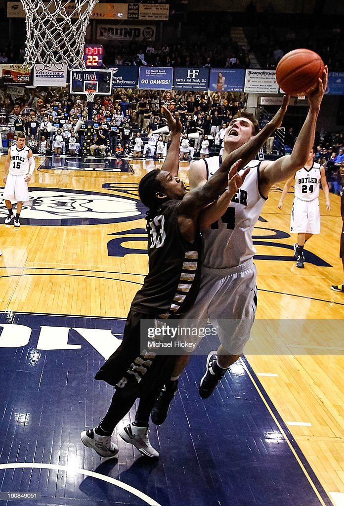 Marquise Simmons #33 of the St. Bonaventure Bonnies defends as <a gi-track='captionPersonalityLinkClicked' href=/galleries/search?phrase=Andrew+Smith+-+Basketball+Player&family=editorial&specificpeople=7641849 ng-click='$event.stopPropagation()'>Andrew Smith</a> #44 of the Butler Bulldogs shoots the ball at Hinkle Fieldhouse on February 6, 2013 in Indianapolis, Indiana. Butler defeated St Bonaventure 77-58.