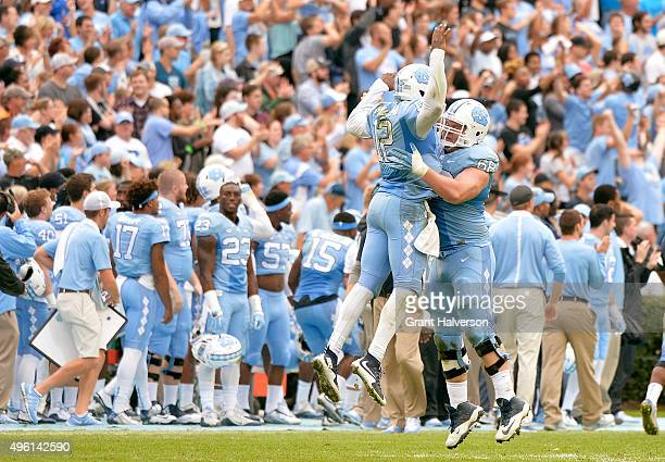 Marquise Williams celebrates with teammate Lucas Crowley of the North Carolina Tar Heels after throwing for a touchdown against the Duke Blue Devils...