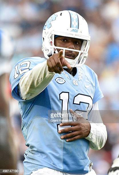 Marquise Williams of the North Carolina Tar Heels directs the offense during their game against the Duke Blue Devils at Kenan Stadium on November 7...