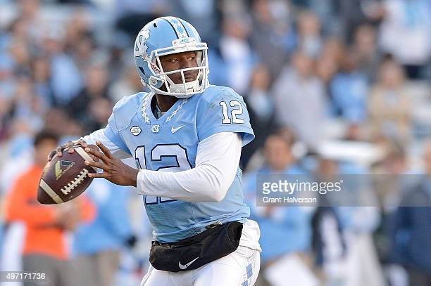 Marquise Williams of the North Carolina Tar Heels looks to pass against the Miami Hurricanes during their game at Kenan Stadium on November 14 2015...