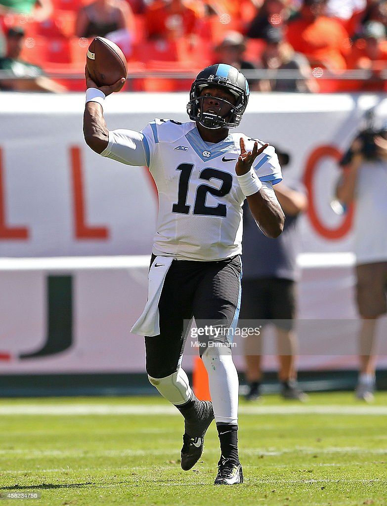 Marquise Williams #12 of the North Carolina Tar Heels passes during a game against the Miami Hurricanes at Sun Life Stadium on November 1, 2014 in Miami Gardens, Florida.