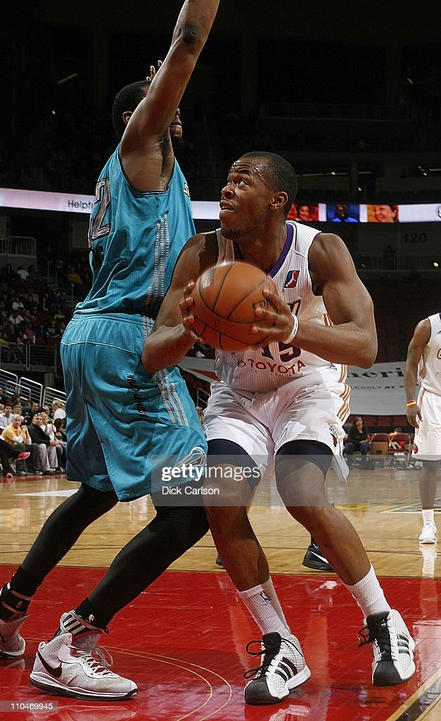 Marqus Blakely of the Iowa Energy drives into Sioux Falls Skyforce defender Patrick Ewing Jr during their game March 18 2011 at the Wells Fargo Arena...