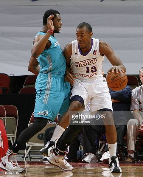 Marqus Blakely of the Iowa Energy presses into Sioux Falls Skyforce defender Patrick Ewing Jr during their game March 18 2011 at the Wells Fargo...