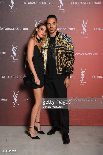 Marracash and guest attend the YSL Beauty Club Party during the 74th Venice Film Festival at Arsenale on September 8 2017 in Venice Italy
