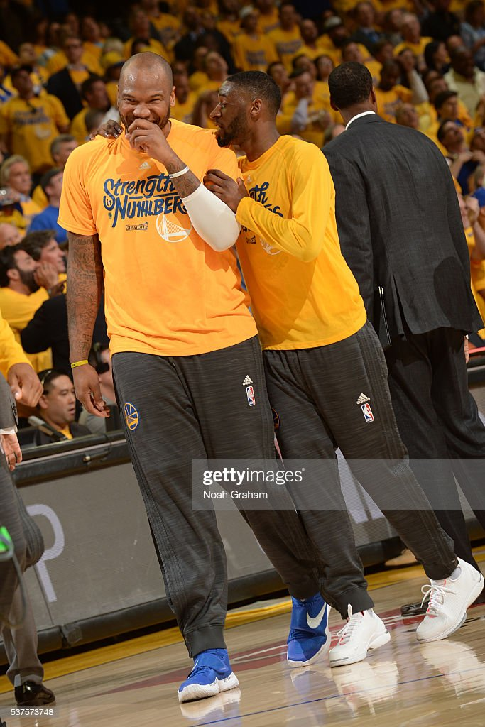 Marreese Speights and Ian Clark of the Golden State Warriors laugh and talk in Game Five of the Western Conference Finals against the Oklahoma City...